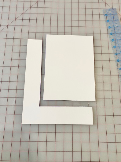 Cut out right angle of board.